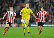 Aston Villas Alan Hutton Southamptons Juanmi and Matt Targett during the Capital One Cup match between Southampton and Aston Villa at the St Mary's Stadium, Southampton, England on 28 October 2015. Photo by Adam Rivers.