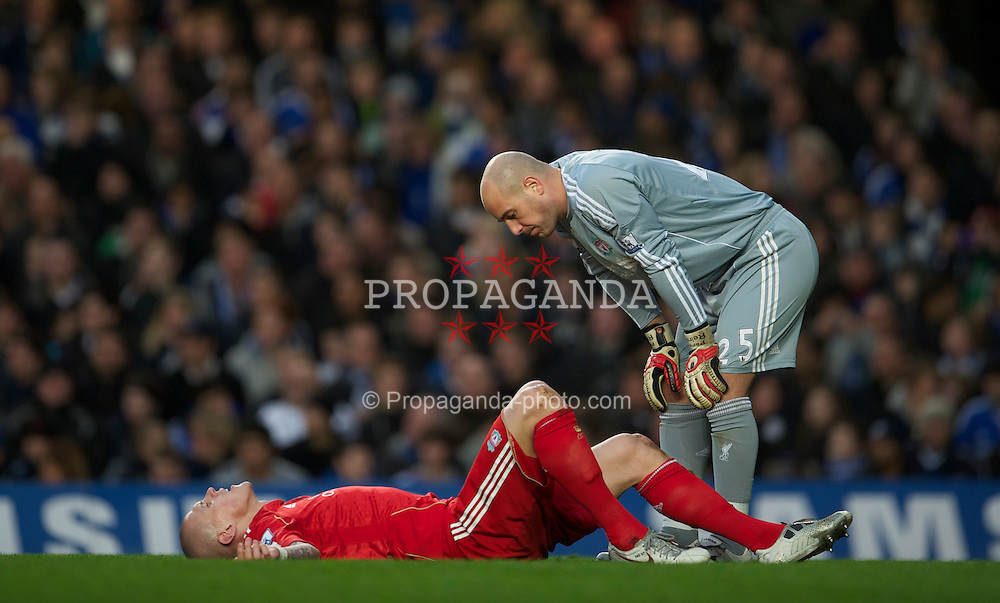 LONDON, ENGLAND - Sunday, February 6, 2011: Liverpool's goalkeeper Jose Reina looks on at the injured Martin Skrtel during the Premiership match against Chelsea at Stamford Bridge. (Photo by David Rawcliffe/Propaganda)