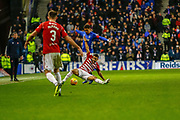 James Tavernier of Rangers  brings down Tom Taiwo of Hamilton Academical FC during the Ladbrokes Scottish Premiership match between Rangers and Hamilton Academical FC at Ibrox, Glasgow, Scotland on 16 December 2018.