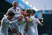 Leeds United forward Patrick Bamford (9) scores a goal and celebrates with Leeds United defender Luke Ayling (2) to make the score 1-0 during the EFL Sky Bet Championship match between Leeds United and Blackburn Rovers at Elland Road, Leeds, England on 9 November 2019.