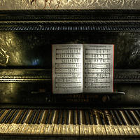 Old piano in a doctors house and practice