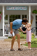 John Roemer and his daughter Elke share an ice cream cone in Fish Creek in Door County, Wisconsin.  (Mike Roemer Photo)