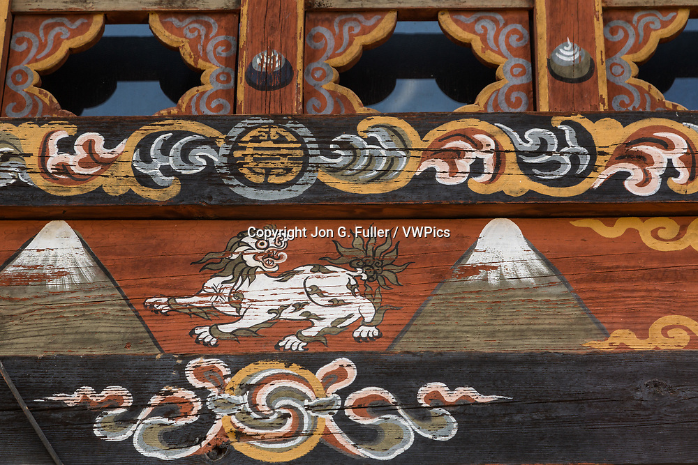 Tibetan snow lion painted on a window frame in Sopsokha, Bhutan.
