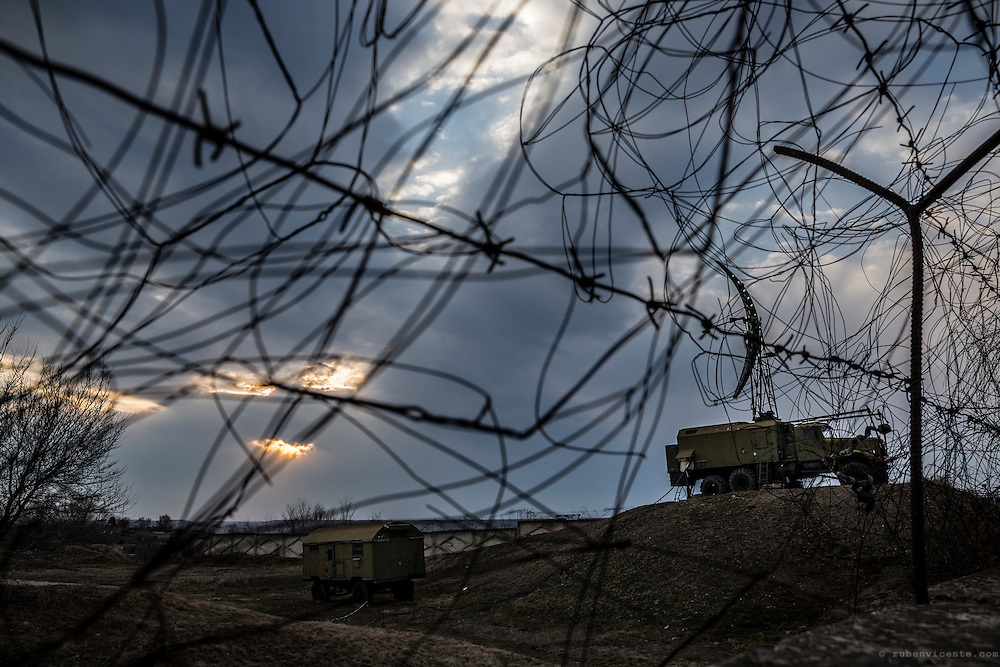 Russian military vehicles and base seen between barbed wire. Gyumri, Armenia