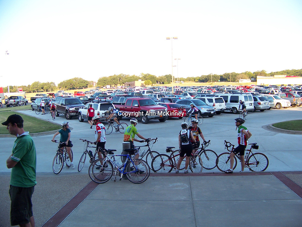 Bicycle riders gathering in early morning for 20, 60, or 80 mile ride at parkling lot of Glen Rose High School, Glen Rose, TX.