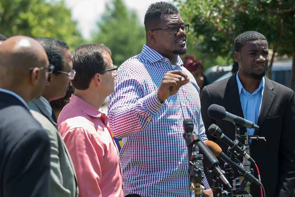 Derrick Golden, senior pastor at Amazing Church, speaks during a press conference outside the McKinney Police Headquarters in McKinney, Texas on June 8, 2015.  (Cooper Neill for The New York Times)