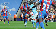 Jason Puncheon powers through Yaya Toure during the Barclays Premier League match between Crystal Palace and Manchester City at Selhurst Park, London, England on 12 September 2015. Photo by Michael Hulf.