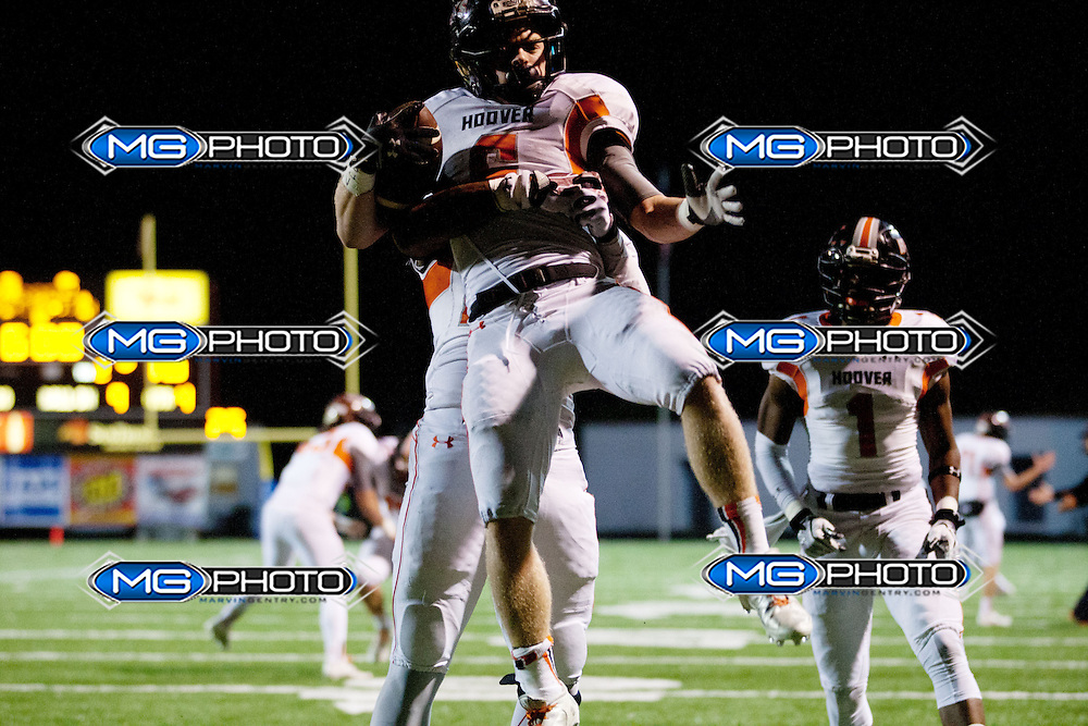 Hoover's Alex Elam celebrates after scoring with a teammate