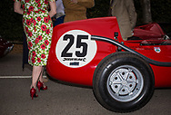A woman dressed in vintage clothing stands next to a period racing car at the paddock leading up to the race track at the Goodwood Revival in Chichester, England   Friday, Sept. 9, 2016 The historic motor racing festival celebrates the mid-20th-century golden era of the racing circuit and recreates the atmosphere from the 1950s and 1960s.(Elizabeth Dalziel)