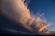 Enormous stormy cloud front stretches from the Pajarito Plateau over the Rio Grande Valley in northern New Mexico at sunset, © 2014 David A. Ponton