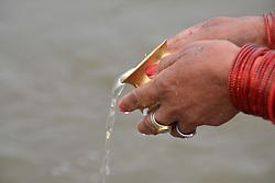 January 2, 2018 - Allahabad, Uttar Pradesh, India - Hindu devotee taking holy dip at Sangam, the confluence of River Ganga, Yamuna and mythological Saraswati on the ocassion of Paush Purnima festival during Magh mela festival celebration in Allahabad  (Credit Image: © Prabhat Kumar Verma/Pacific Press via ZUMA Wire)