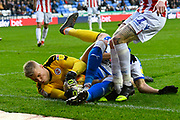 Anssi Jaakkola (31) of Reading dives on the ball at the feet of Tiago Ilori (20) of Reading and James McClean (11) of Stoke City during the EFL Sky Bet Championship match between Reading and Stoke City at the Madejski Stadium, Reading, England on 1 December 2018.
