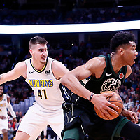 01 April 2018: Milwaukee Bucks forward Giannis Antetokounmpo (34) drives past Denver Nuggets forward Juan Hernangomez (41) during the Denver Nuggets 128-125 victory over the Milwaukee Bucks, at the Pepsi Center, Denver, Colorado, USA.