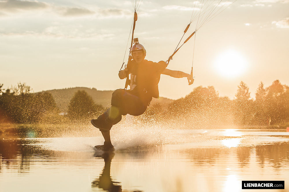 Dominic Roithmair of the Red Bull Skydive Team swoops the pond in Klatovy during a nice sunset.