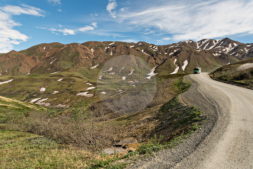 View of the Park Road as it crosses the tundra at Savage River in Denali National Park Alaska. Denali National Park and Preserve encompasses 6 million acres of Alaska's interior wilderness.