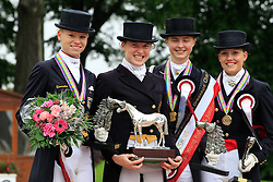 Prize giving Young Riders Kür  : <br /> 1. Sanneke Rothenberger (GER)<br /> 2. Annabel Frenzen (GER)<br /> 3. Cathrine Dufour (DEN)<br /> And Tahnee Waelkens (BEL) who received the best style price.<br /> European Championship Dressage Young Riders - Broholm 2011
