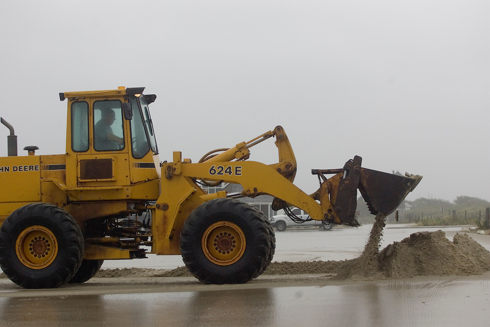 (PPAGE1) Sandy Hook. 9/2/2006  A Park Ranger uses a front end loader to move sand that was piling up in the parking lot that houses the Sea Gull's nest at Sandy Hook.   Michael J. Treola Staff Photographer.....MJT