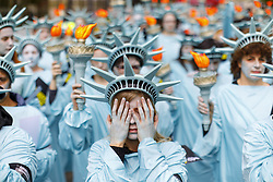 April 27, 2017 - London - One hundred Amnesty International activists dressed as 'Statues of Liberty' protest outside the US Embassy in London o mark US President Trump's first 100 days in office. (Credit Image: © Tolga Akmen/London News Pictures via ZUMA Wire)