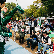 TOKYO, JAPAN - MAY 1 : A demonstrator wearing a costume with a dragon head, Shinzo Abe and Donald Trump effigies poses for a photo during the May Day Rally at Yoyogi Park on May 1, 2017 in Tokyo, Japan. (Photo by Richard Atrero de Guzman/NUR Photo)