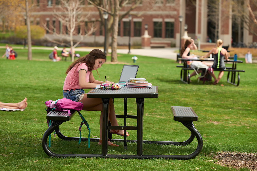 Activity; Studying; Drake Field; Location; Outside; Objects; Computer; People; Student Students; Spring; April; Time/Weather; sunny; Type of Photography; Candid; UWL UW-L UW-La Crosse University of Wisconsin-La Crosse; Woman Women