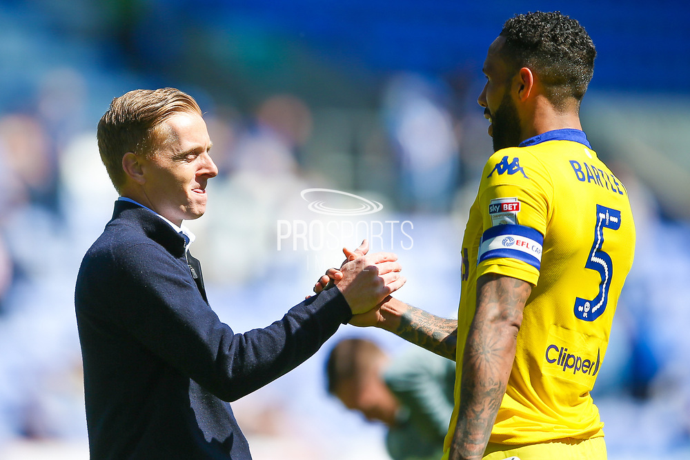 Leeds United manager Garry Monk shakes the hand of Leeds United defender, on loan from Swansea City, Kyle Bartley (5)  during the EFL Sky Bet Championship match between Wigan Athletic and Leeds United at the DW Stadium, Wigan, England on 7 May 2017. Photo by Simon Davies.