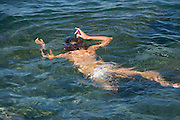 child snorkeling