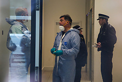 © Licensed to London News Pictures. 23/11/2019. London, UK. Forensic officers are seen inside iBlakeney Tower on Buckle Street in Tower Hamlets, East London following a fatal stabbing.<br /> Police were called to a residential address in Blakeney Tower on Buckle Street, Tower Hamlets in East London at 08.48hrs this morning following reports of a stabbing. A male, in his 20s, was found with stab injuries. Despite the efforts of emergency services, he was pronounced dead at the scene. Three other males with stab injuries were treated at the scene by paramedics before being taken to hospital. Photo credit: Dinendra Haria/LNP