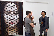 "Vienna, Austria. Galerie Suppan Contemporary. Vernissage of Zico Albaiquni (r., Indonesia), ""beyond the veil"""