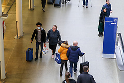 © Licensed to London News Pictures. 13/03/2020. London, UK. A man wearing face mask arrives at St Pancras International departures amid an increased number of Coronavirus (COVID-19) cases in the UK. 798 cases have been tested positive and ten patients have died from the virus in the UK. Photo credit: Dinendra Haria/LNP
