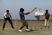 Young boys from in the fishermen villages located along the shipbreaking yards playing cricket.