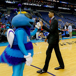 Apr 14, 2013; New Orleans, LA, USA; New Orleans Hornets mascot Hugo with New Orleans Hornets power forward Anthony Davis following a loss to the Dallas Mavericks at the New Orleans Arena. The Mavericks defeated the Hornets 107-89. The game was the final home game for the Hornets franchise as they will be rebranded as the New Orleans Pelicans starting next season. Mandatory Credit: Derick E. Hingle-USA TODAY Sports