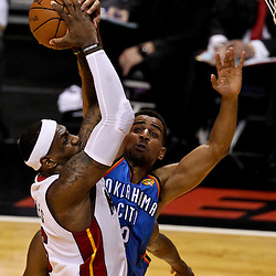 Jun 19, 2012; Miami, FL, USA; Miami Heat small forward LeBron James (6) shoots over Oklahoma City Thunder shooting guard Thabo Sefolosha (2) during the first quarter in game four in the 2012 NBA Finals at the American Airlines Arena. Mandatory Credit: Derick E. Hingle-USA TODAY SPORTS