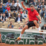 PARIS, FRANCE June 05. Goran Ivanisevic of Croatia jumps over the net while playing with Sergi Bruguera of Spain against Mansour Bahrami of France and Fabrice Santoro of France on Court Simonne-Mathieu during the Men's Legends over 45 competition at the 2019 French Open Tennis Tournament at Roland Garros on June 5th 2019 in Paris, France. (Photo by Tim Clayton/Corbis via Getty Images)