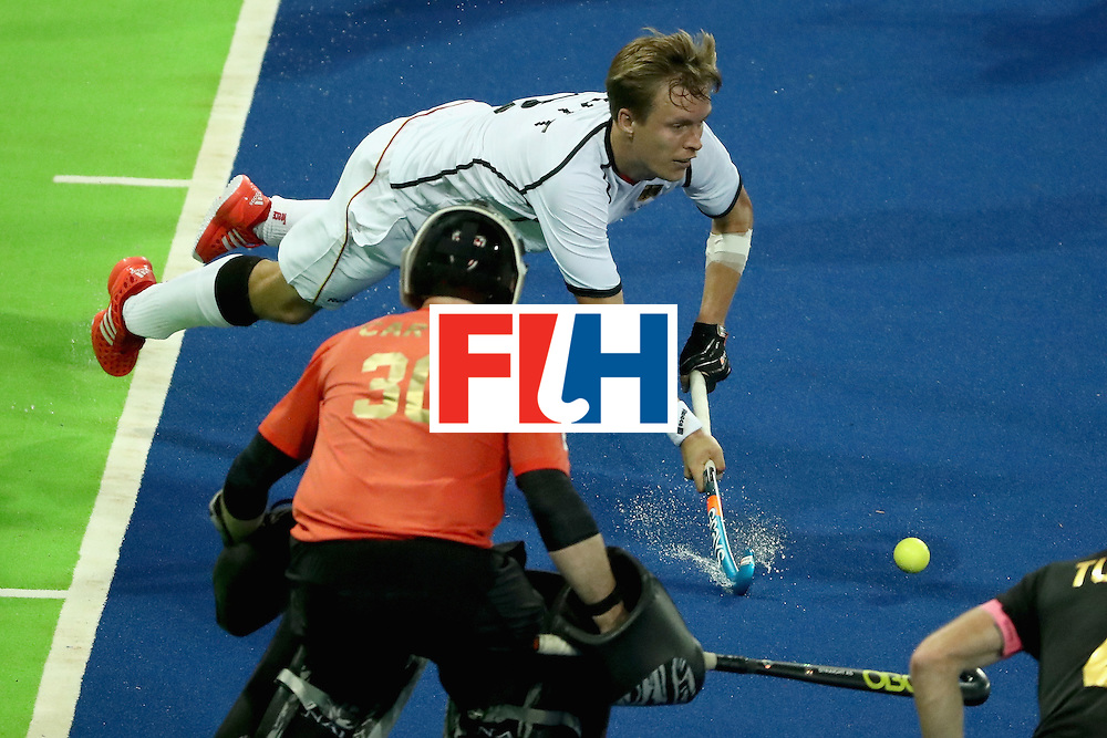 RIO DE JANEIRO, BRAZIL - AUGUST 06:  Linus Butt #3 of Germany leaps to make a shot during a Men's Pool B match between Germany and Canada on Day 1 of the Rio 2016 Olympic Games at the Olympic Hockey Centre on August 6, 2016 in Rio de Janeiro, Brazil.  (Photo by Sean M. Haffey/Getty Images)