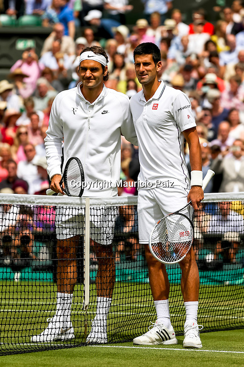 LONDON, ENGLAND - JULY 6: Roger Federer of Switzerland and Novak Djokovic of Serbia take their prematch photo during the Gentlemens' Singles final match on day thirteen of the Wimbledon Lawn Tennis Championships at the All England Lawn Tennis and Croquet Club at Wimbledon on July 6, 2014 in London, England.