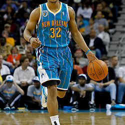October 29, 2010; New Orleans, LA, USA; New Orleans Hornets point guard Jerryd Bayless (32) controls the ball during the fourth quarter against the Denver Nuggets  at the New Orleans Arena. The Hornets defeated the Nuggets 101-95.  Mandatory Credit: Derick E. Hingle