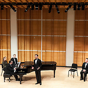 """May 22, 2012 - New York, NY : The Mirror Visions Ensemble's baritone Jesse Blumberg, standing, and pianist Alan Darling, second from left, perform during a presentation of """"A Score of Scores: 20 Years of Mirror Visions"""" at Merkin Concert Hall in Manhattan on Tuesday evening. Also pictured are pianists Margaret Kampmeier, far left, (not performing) and Gary Chapman, third from left, (not performing), and from right, soprano Vira Slywotzky and tenor Scott Murphree (not performing).  CREDIT: Karsten Moran for The New York Times"""