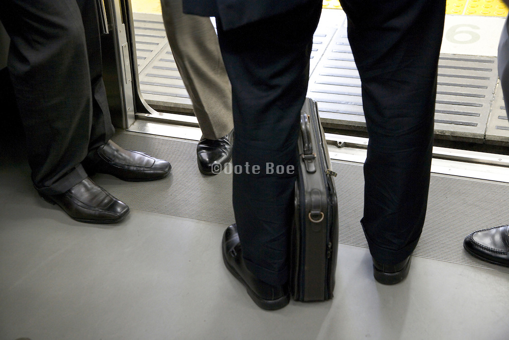 businessmen meeting up at the door entrance of a train