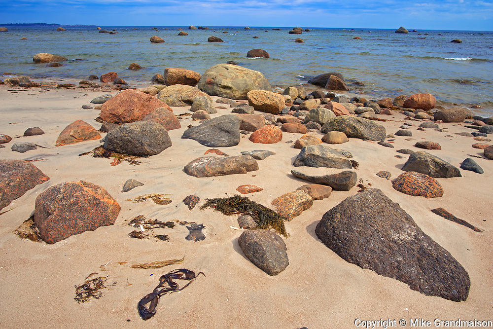 Rocky shoreline and sand along the North Shore of the Gulf of St. Lawrence<br />Rivière-au-Tonnerre<br />Quebec<br />Canada