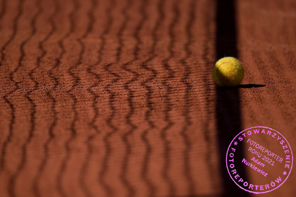 Tennis ball in the shadow on the court during tennis tournament Tomaszewski Cup 2013 at Legia's courts in Warsaw.<br /> <br /> Poland, Warsaw, September 07, 2013<br /> <br /> Picture also available in RAW (NEF) or TIFF format on special request.<br /> <br /> For editorial use only. Any commercial or promotional use requires permission.<br /> <br /> Photo by &copy; Adam Nurkiewicz / Mediasport