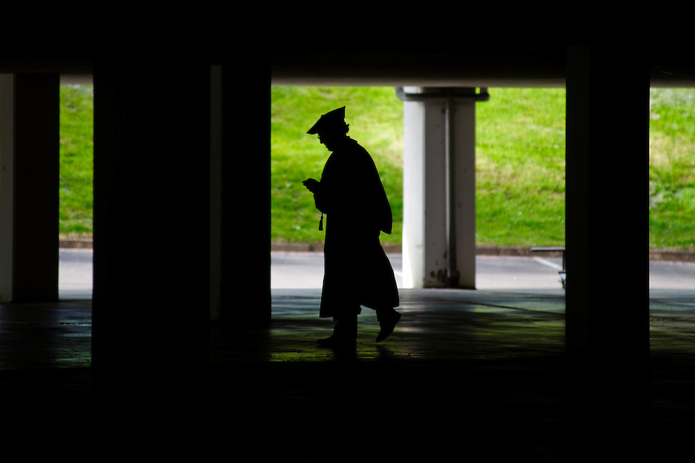 An Ohio University faculty member walks underneath the Convocation Center before the first undergraduate commencement ceremony, Saturday, May 4, 2013. There were two undergraduate commencement ceremonies, one at 9:30 a.m. and one at 2:00 p.m.