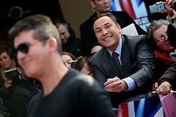 Britain's Got Talent. David Walliams (C) pretends to be a fan of Simon Cowell (L) as he arrives to Britain's Got Talent at Hammersmith Apollo.Hammersmith Apollo, London, United Kingdom. Thursday, 13th February 2014. Picture by Peter Kollanyi / i-Images