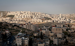 © London News Pictures. 14/03/2011. The Israeli security barrier divides the Palestinian town of Abu Dis from occupied east-Jerusalem. Built mostly on Palestinian land the 'security barrier' has been called 'an obstacle to peace' and branded illegal under the Geneva Conventions. 13/03/11