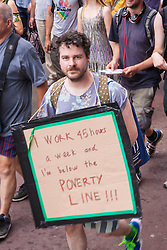 London, June 21st 2014. Many anti-cuts protesters also carried placards highlighting the need for a living wage.