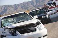 Police officer arrives at scene of carcrash