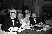 28/04/1965<br /> 04/28/1965<br /> 28 April 1965<br /> Festival of Kerry Dublin Ball at the Gresham Hotel, Dublin. Photo shows (l-r): JudgesTommy Hennigan; Frances McDermott and Donal O'Morain.