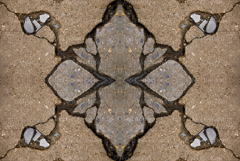 Kaleidoscope of two mirror images or4 iimage of broken cracked sidewalk abstract of patterns and textures