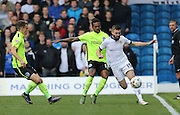 Leeds United midfielder Stuart Dallas (15) battles for possession with Brighton defender, full back, Gaetan Bong (12) during the Sky Bet Championship match between Leeds United and Brighton and Hove Albion at Elland Road, Leeds, England on 17 October 2015.