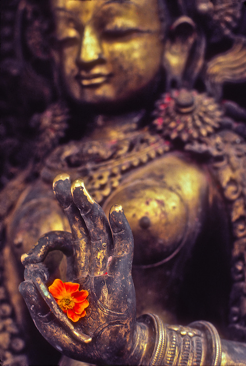 A bronze of Tara, the Buddhist fertility  goddess who personifies female energy, at the Swyambhunath  temple complex overlooking the Nepal's richly fertile Kathmandu Valley