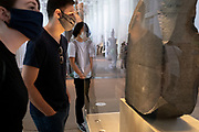 Now re-opened after months of closure during the Coronavirus pandemic, some of the first visitors who have pre-booked free tickets, can once again enjoy the historical artifacts, including the Rosetta Stone, at the British Museum, on 2nd September 2020, in London, England.